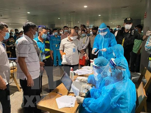 Detectan dos nuevos casos de COVID-19 relacionados con el brote en Ciudad Ho Chi Minh hinh anh 2