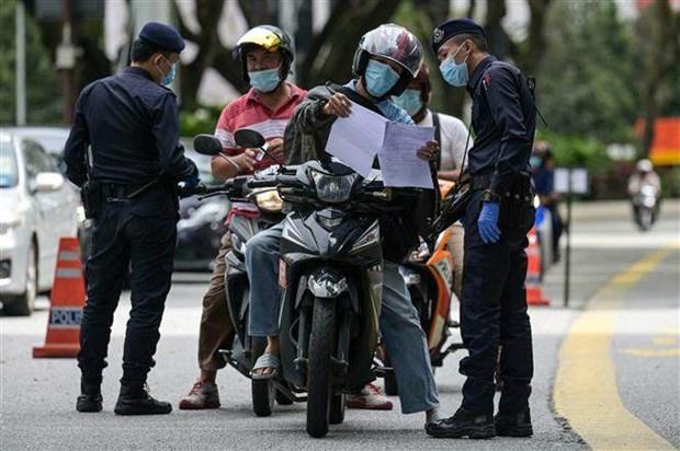 Malasia prolonga la Orden de Control de Movimiento por el COVID-19 hinh anh 1