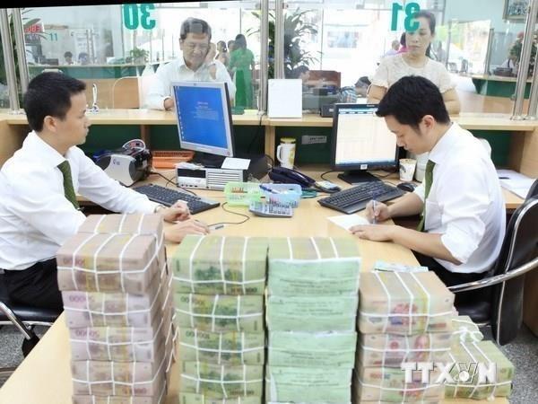 Disminuye tasa de ejecucion de presupuesto estatal de Vietnam en febrero hinh anh 1