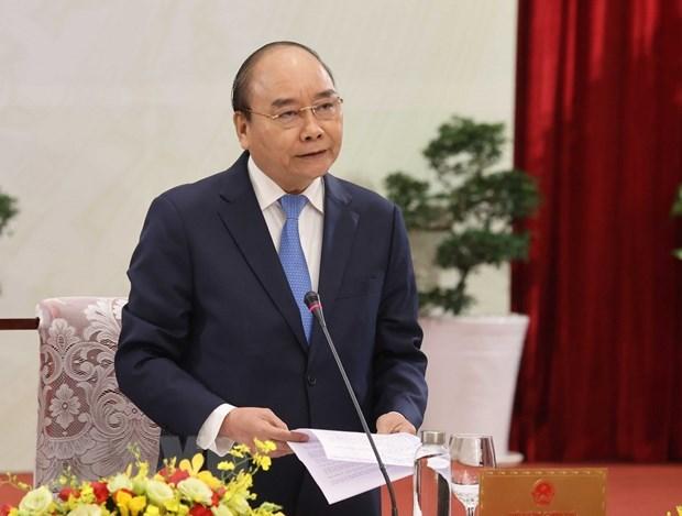 Dialoga premier de Vietnam con comunidad empresarial hinh anh 2