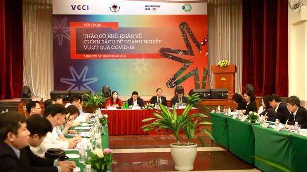 Empresas vietnamitas, con altas expectativas en las politicas auxiliares del Gobierno hinh anh 1