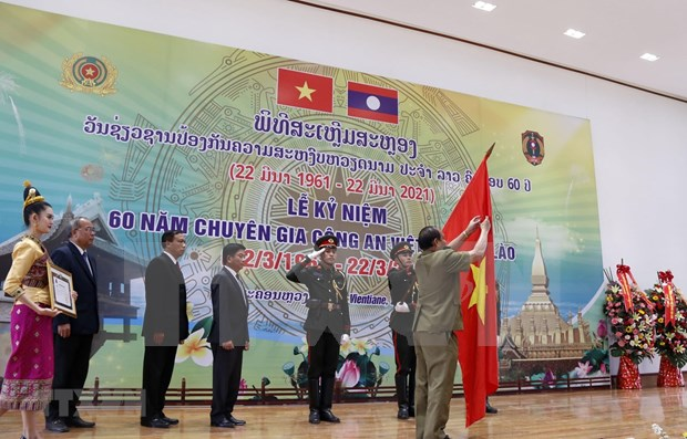 Mitin rememora 60 anos del envio de expertos policiales de Vietnam en apoyo a Laos hinh anh 1