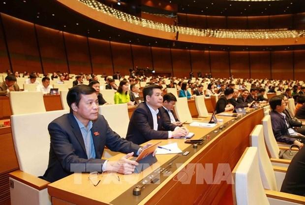 Parlamento de Vietnam discute borrador del informe sobre la XIV Legislatura hinh anh 1