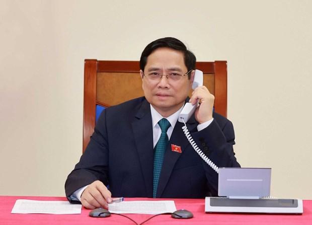 Primer ministro de Laos felicita a su homologo vietnamita Pham Minh Chinh hinh anh 1