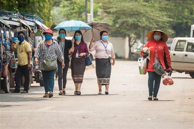 Laos y Tailandia refuerzan medidas de prevencion contra el COVID-19 hinh anh 1