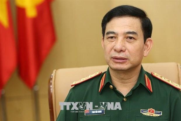 Vietnam y Laos debaten medidas para intensificar cooperacion en defensa hinh anh 1
