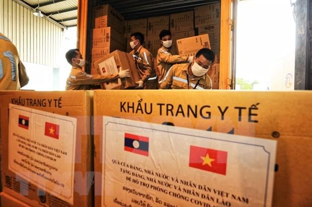 Aprecia medio laosiano ayuda de Vietnam en combate contra el COVID-19 hinh anh 1