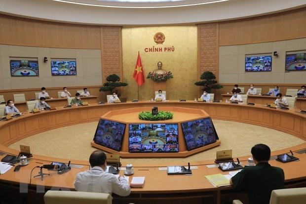 Primer ministro de Vietnam insta a garantizar la seguridad y salud de la poblacion ante COVID-19 hinh anh 3