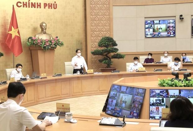 Primer ministro de Vietnam insta a garantizar la seguridad y salud de la poblacion ante COVID-19 hinh anh 2