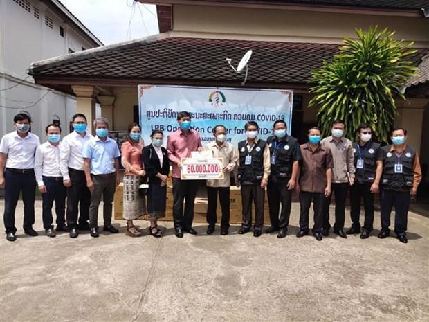 Diplomaticos de Vietnam apoyan a provincia laosiana contra el COVID-19 hinh anh 1