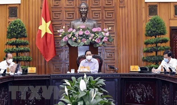 Premier vietnamita destaca importancia de participacion de pobladores en lucha contra el COVID-19 hinh anh 2