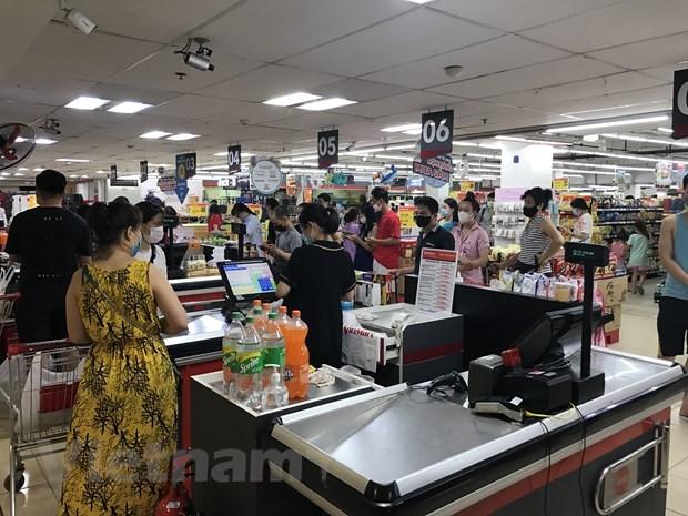 Vietnam garantiza oferta y demanda de mercancias en medio del COVID-19 hinh anh 1