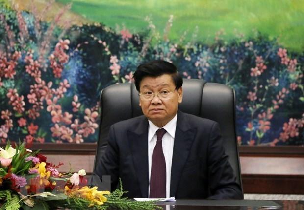 Agradece maximo lider laosiano apoyo de Vietnam en lucha contra COVID-19 hinh anh 1