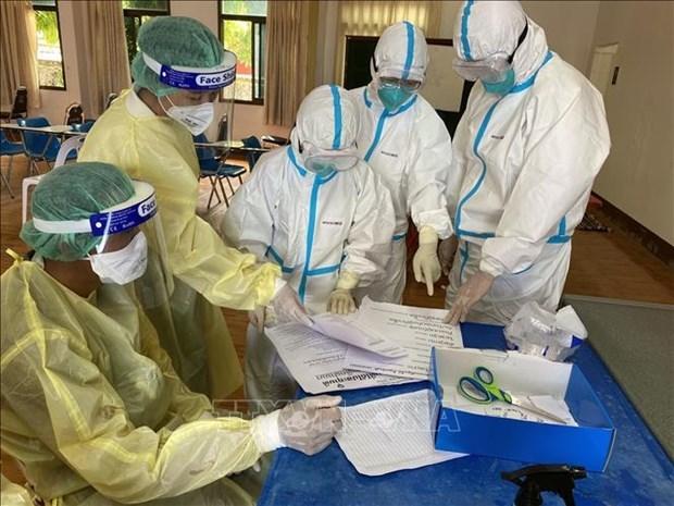 Laos valora experiencias de expertos vietnamitas contra el COVID-19 hinh anh 1