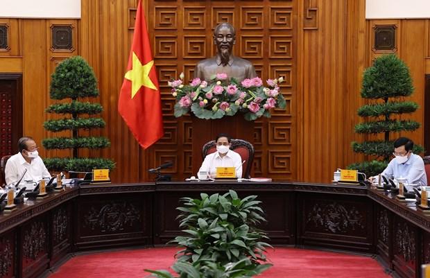 Primer ministro de Vietnam preside reunion sobre la lucha contra COVID-19 hinh anh 1