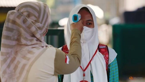 Indonesia amplia restricciones a actividades comunitarias en medio del COVID-19 hinh anh 1