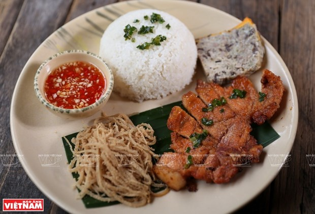 Com tam, un plato de la firma de Saigon hinh anh 1