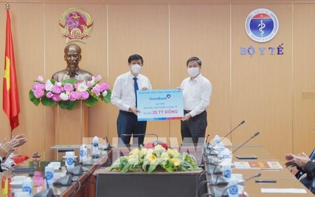 Sector bancario de Vietnam dona al fondo nacional para comprar vacunas contra el COVID-19 hinh anh 2