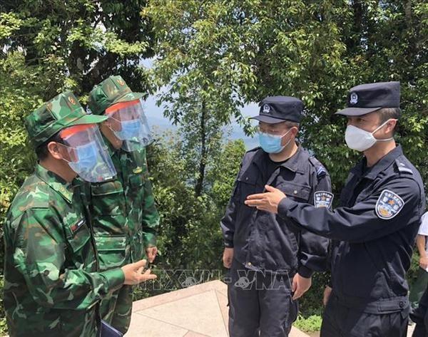 Vietnam, China y Laos cooperan en la gestion y proteccion de fronteras hinh anh 2