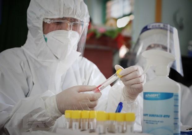 Aplican cuarentena medica a un edificio en Hanoi por el COVID-19 hinh anh 1