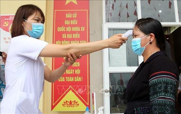 Vietnam sigue reforzando la lucha contra el COVID-19 en medio de elecciones legislativas hinh anh 1