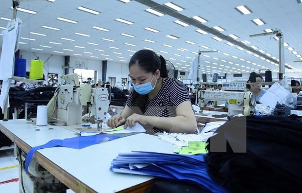 Nueva ola de COVID-19 genera inquietud entre fabricantes textiles de Vietnam hinh anh 1