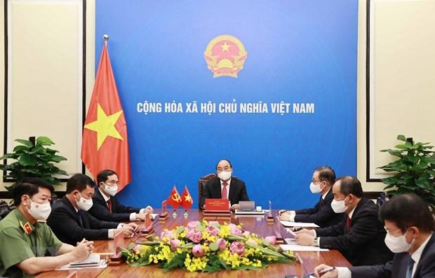 Presidente de Vietnam aboga por impulso de cooperacion contra COVID-19 con China hinh anh 1