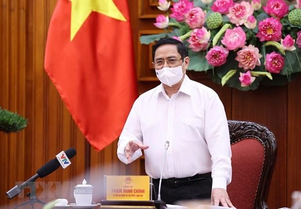 Pide premier de Vietnam establecer fondo para vacunacion antiCOVID-19 hinh anh 1