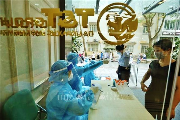 COVID-19: un centenar de nuevos casos en Vietnam esta manana hinh anh 1