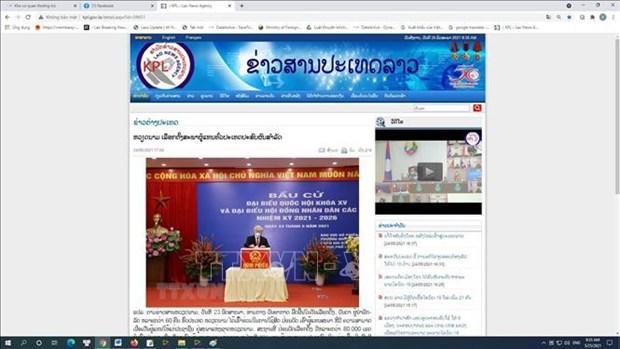 Periodicos laosianos destacan exito de elecciones legislativas de Vietnam hinh anh 1