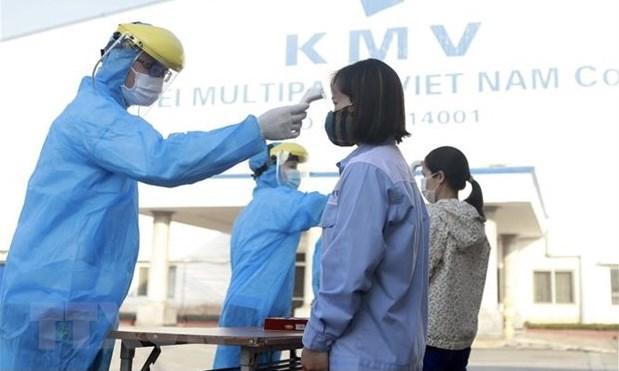 Primer ministro vietnamita insta a garantizar prevencion y control del COVID-19 en parques industriales hinh anh 1