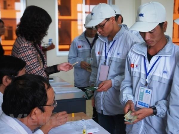 Vietnam y OIT firman memorando de cooperacion sobre normas internacionales de trabajo hinh anh 1