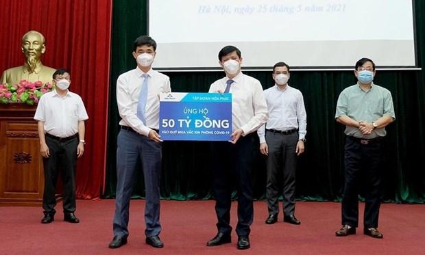 Reciben apoyo en Vietnam para el Fondo nacional de Vacunas contra el COVID-19 hinh anh 2