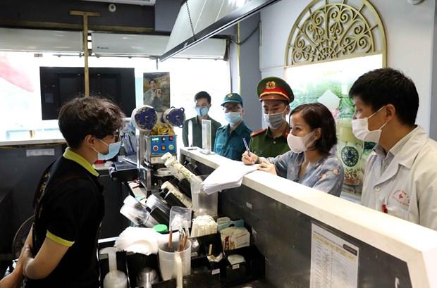 Hanoi despliega medidas sincronicas e integrales en lucha contra el COVID-19 hinh anh 2