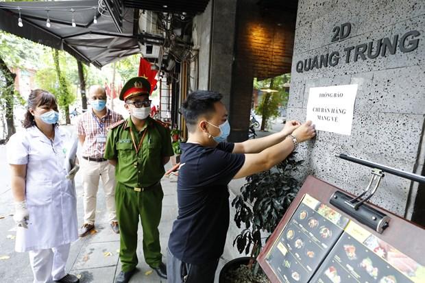 Hanoi despliega medidas sincronicas e integrales en lucha contra el COVID-19 hinh anh 1