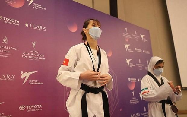 Taekwondista vietnamita se clasifica para los Juegos Olimpicos de Tokio hinh anh 1