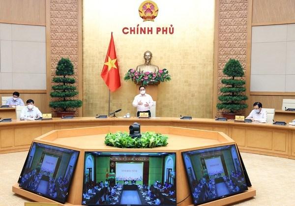 Primer ministro de Vietnam pide mayores esfuerzos para eliminar focos de la cuarta ola de COVID-19 hinh anh 1