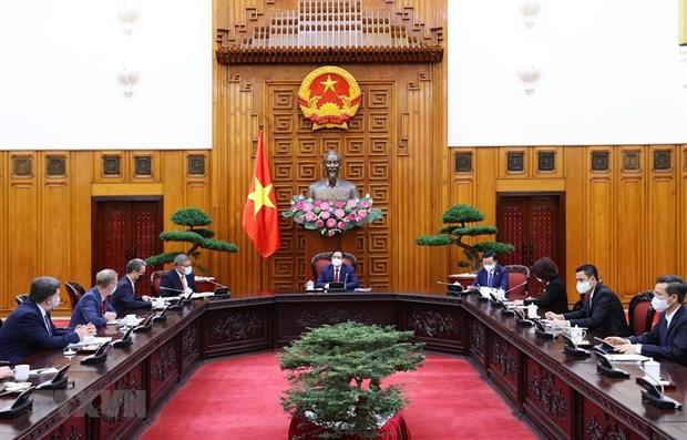 Primer ministro de Vietnam recibe a presidente de COP26 hinh anh 1