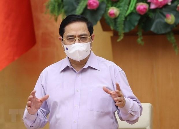 Premier vietnamita insta a controlar y repeler el COVID-19 en areas clave hinh anh 1