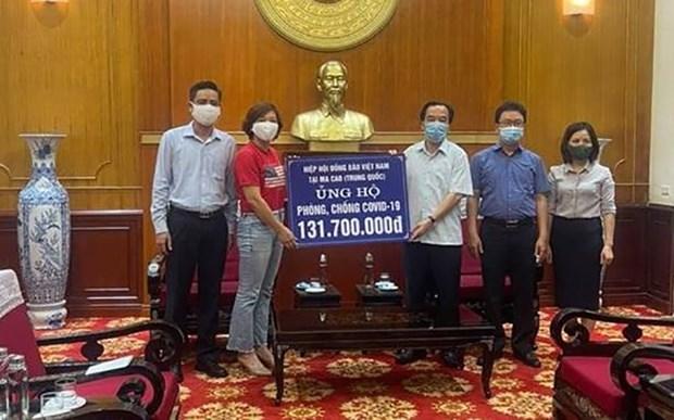 Vietnamitas en Macao apoyan a su pais de origen en lucha contra el COVID-19 hinh anh 1