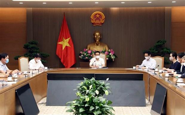 Vicepremier de Vietnam recibe a empresas donantes a fondo nacional de vacunacion contra COVID-19 hinh anh 1
