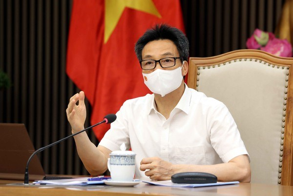 Vicepremier de Vietnam recibe a empresas donantes a fondo nacional de vacunacion contra COVID-19 hinh anh 2