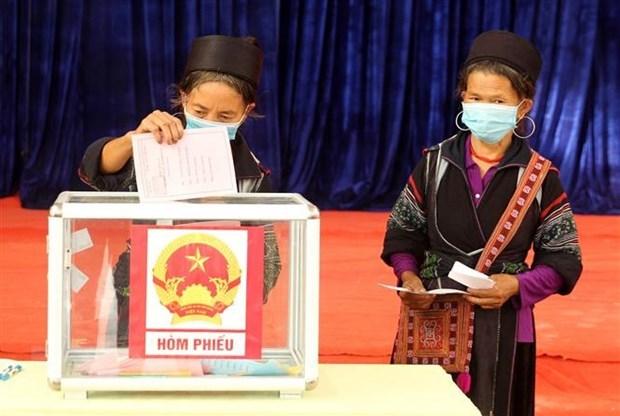 Alta tasa de participacion en elecciones refleja confianza de la poblacion en el Partido y Estado hinh anh 1