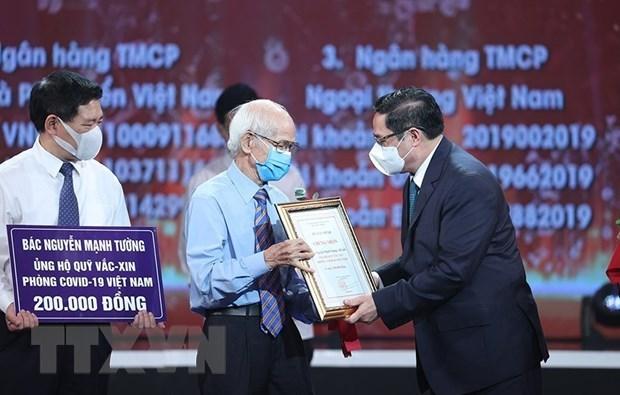 Vietnam lanza Fondo Nacional de Vacunas contra el COVID-19 hinh anh 2
