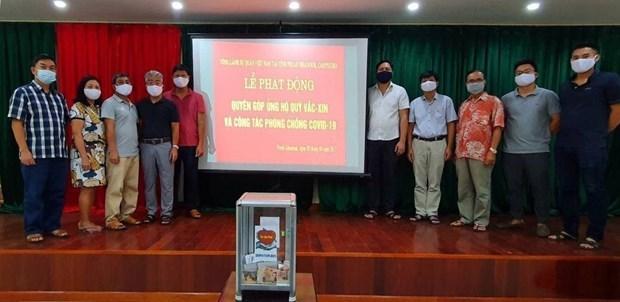 Vietnamitas en Camboya apoyan al Fondo Nacional de Vacunas contra COVID-19 hinh anh 1