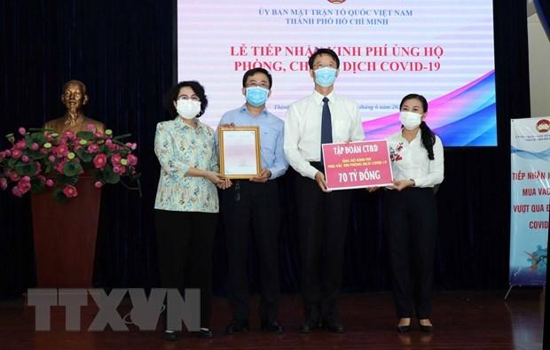 Ciudad Ho Chi Minh recibe 4,3 millones de dolares en apoyo a lucha contra el COVID-19 hinh anh 1