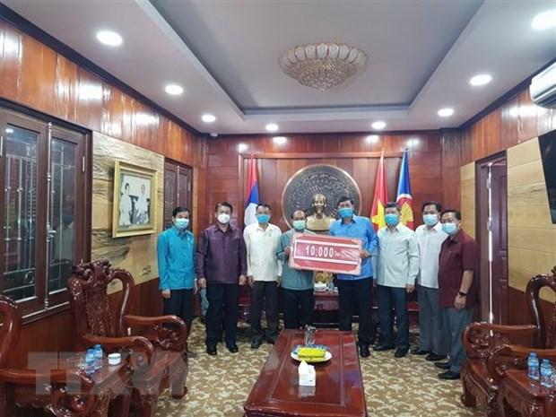 Laos une esfuerzos con Vietnam para combatir el COVID-19 hinh anh 1