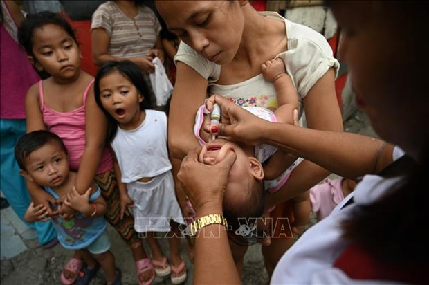 Alaban OMS y UNICEF esfuerzos de Filipinas por erradicar la epidemia de polio hinh anh 1