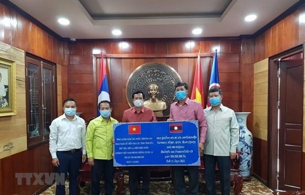 Provincias laosianas se unen a esfuerzos de Vietnam en lucha contra COVID-19 hinh anh 1