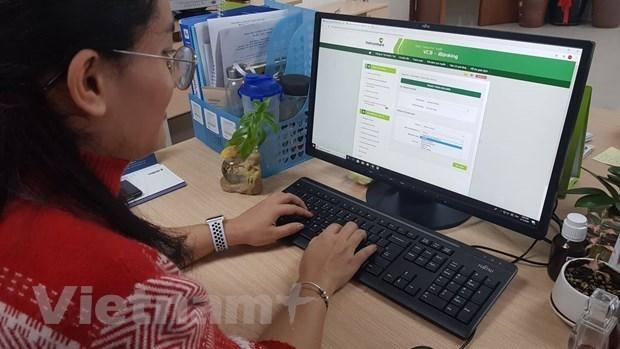 Amplias actividades en Vietnam en respuesta al Dia sin efectivo hinh anh 1